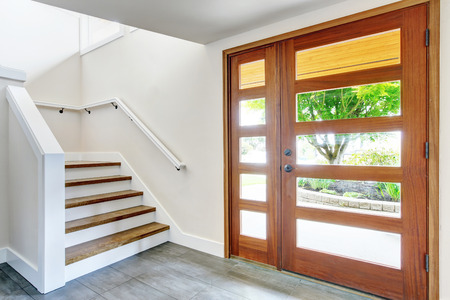 Nice entry way to home with carpet staircase and white interior. Northwest, USA Stock Photo