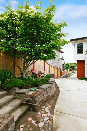 northwest: Fenced backyard with concrete driveway to garage. Northwest, USA