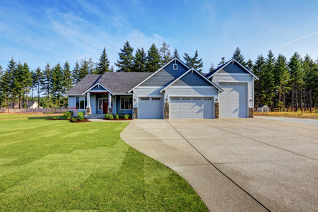 garage on house: Luxury blue house with curb appeal. Three car garage and long, wide asphalt driveway. Northwest, USA