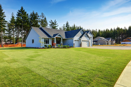 curb: Luxury blue house with curb appeal and well kept lawn. Northwest, USA