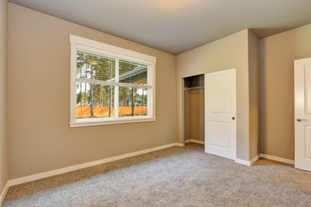 remodeled: Brand new house construction interior. Beige Empty room with closet and carpet floor. Northwest, USA