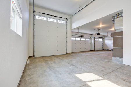 garage on house: Interior of a large three car garage in a brand new house. Northwest, USA