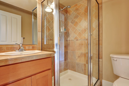 screened: Traditional bathroom with glass screened shower with tile wall trim and bathroom vanity. Northwest, USA
