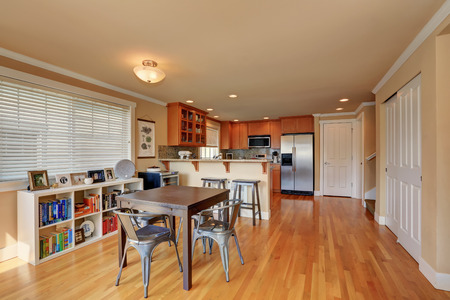 open floor plan: Open floor plan. Dining and kitchen room interior with hardwood floor. Northwest, USA Stock Photo