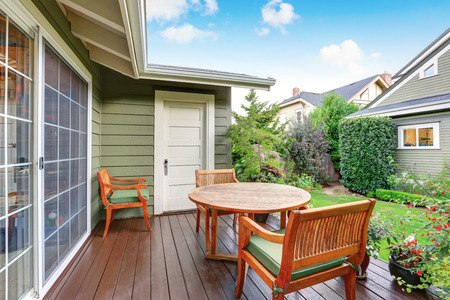 guest house: View of back deck with wooden table set and nice view. Guest house exterior. Northwest, USA