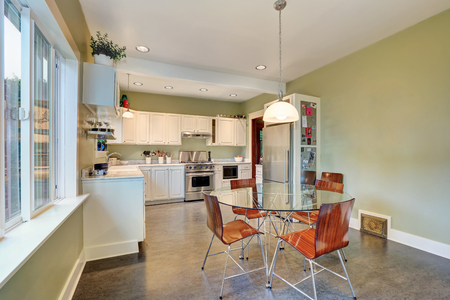 back kitchen: View of dining table with glass top and modern chairs. Also white  kitchen storage combination at the back. Northwest, USA