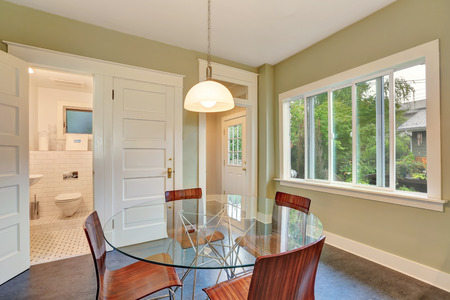 dining table and chairs: Modern Dining table view and metal chairs with wooden seats. bathroom view. Northwest, USA