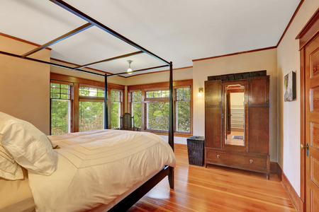 antique furniture: Interior of master bedroom with canopy bed and beautiful antique furniture. Northwest, USA