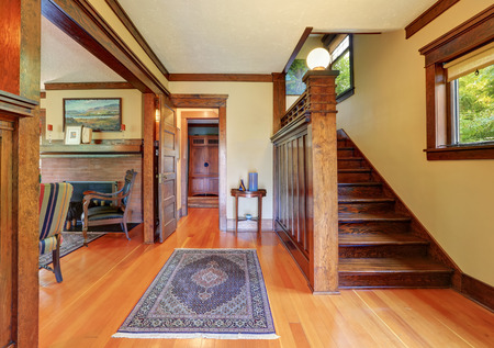 entryway: Entryway with wooden staircase and hardwood floor. Northwest, USA Stock Photo
