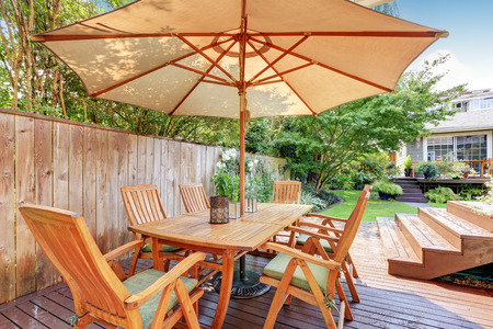 northwest: House exterior. Wooden patio table set with umbrella. Northwest, USA