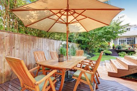 northwest: House exterior. Wooden patio table set with umbrella. Northwest, USA