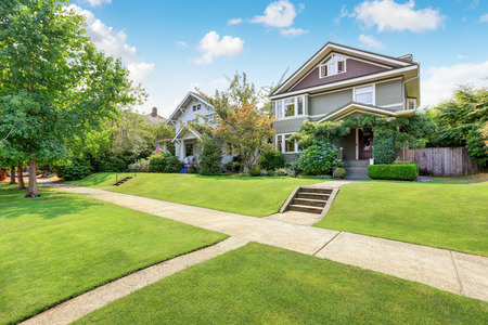 house exterior: American family house exterior with perfectly kept lawn .Northwest, USA Stock Photo