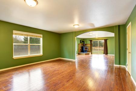 open floor plan: Open floor plan interior with green walls and hardwood floor. . Northwes, USA Stock Photo