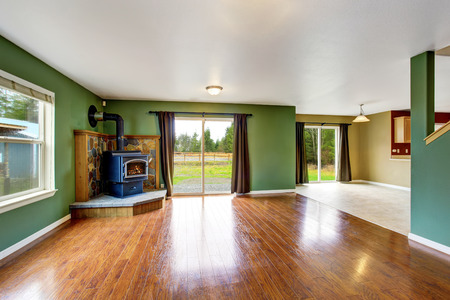 green walls: Open floor plan interior with green walls, brown curtains, fireplace and hardwood floor. . Northwes, USA