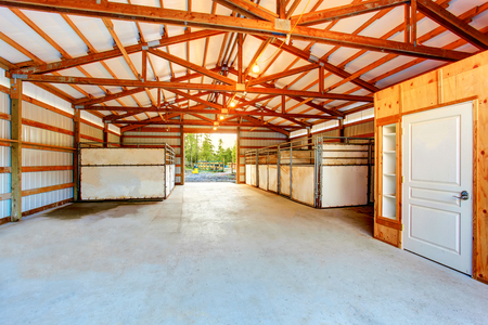 farm structures: Wooden interior of horse stable. Northwes, USA