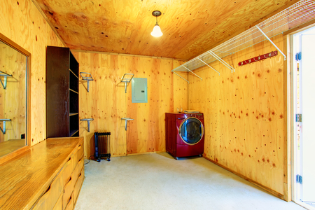 dryer  estate: Simple laundry room with wooden trim in old farm house. Northwes, USA Stock Photo