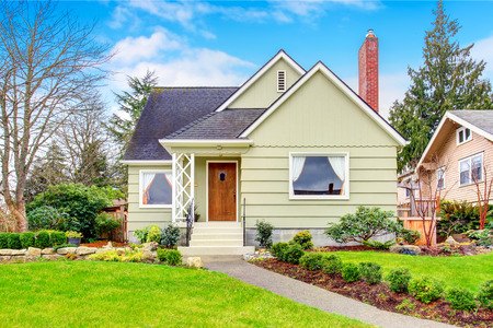 Small American house with well kept lawn and nice landscaping desing around. Northwest, USA