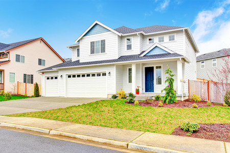 garage on house: Luxury two level house exterior with garage and concrete driveway. Northwest, USA Stock Photo