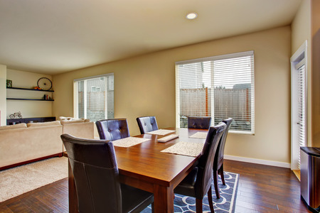 table and chairs: Dining area with wooden table set and leather chairs. Connected to living room. Northwest, USA Stock Photo