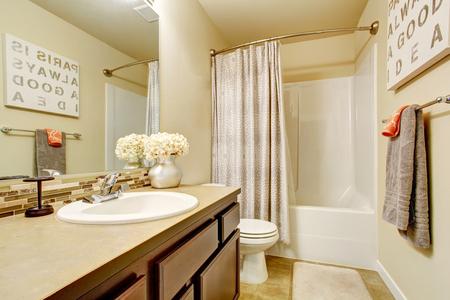 bathroom tile: Bathroom interior with vanity cabinet and tile floor. Northwest, USA