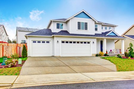 Luxury two level house exterior with garage and concrete driveway. Northwest, USA Stock Photo