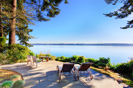 Backyard patio area with chairs, concrete walkway and amazing view. Northwest, USA