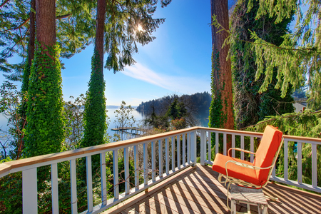 Walkout deck  with chairs and amazing water view. Northwest, USA