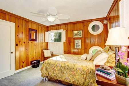 northwest: Craftsman bedroom interior with wooden pannel walls. Northwest, USA Stock Photo