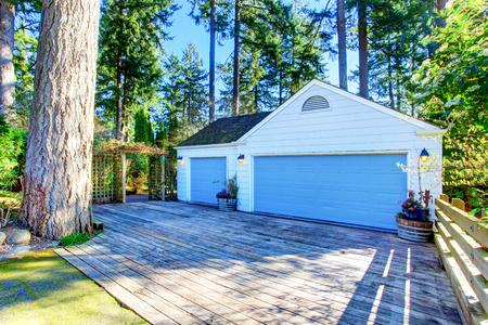 northwest: Separate garage with blue door and wooden driveway. Northwest, USA