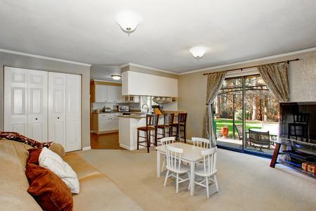 open floor plan: Open floor plan living room with fireplace, carpet floor. Also Kids table set. Northwest, USA