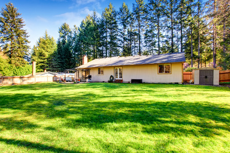 lawn area: Spacious backyard with patio area and well kept lawn. Northwest, USA Stock Photo