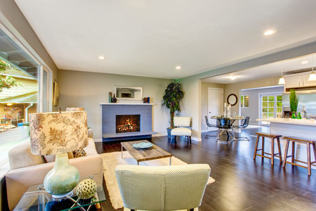 open plan: Open floor plan. Cozy living room interior with fireplace and hardwood floor. Northwest, USA Stock Photo