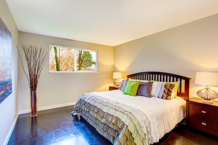 king size: Bedroom interior with beige walls, deep brown hardwood floor and king size bed. Northwest, USA