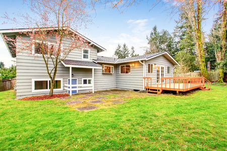 two story: Two story house with wooden walkout deck. Fenced backyard. Northwest, USA