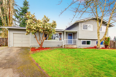 Two story house exterior with garage, driveway and well kept lawn. Northwest, USA Stock Photo