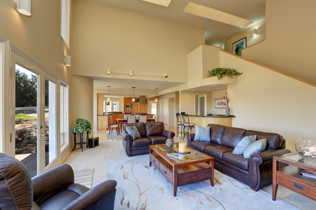 the vaulted: Great living room interior with high vaulted ceiling. Glass doors lead to the walkout deck. Northwest, USA