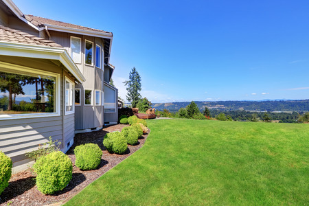 house windows: Luxury house exterior with grass filled garden and shrubs. Perfect landscape view. Northwest, USA