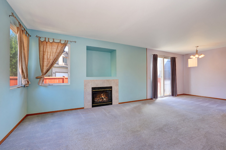 fireplace living room: Empty living room interior with blue and lavender pastel color walls and fireplace. Northwest, USA