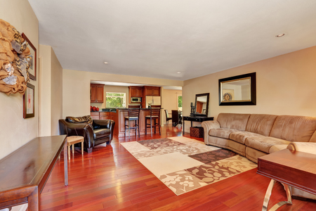 view of a spacious living room: Cozy Spacious living room with cherrywood floor. Entrance door view. Northwest, USA