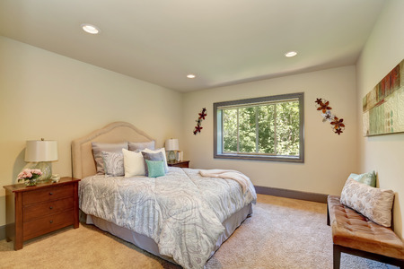 queen bed: Elegant white bedroom with queen size bed and nightstands. View of comfortable bench with pillows. Northwest, USA