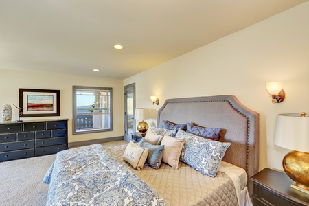 queen bed: Elegant white bedroom with queen size bed and nightstands. View of large black chest of drawers. Northwest, USA