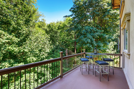 second floor: Second floor balcony with outdoor table and chair set. Nice landscape view. Northwest, USA