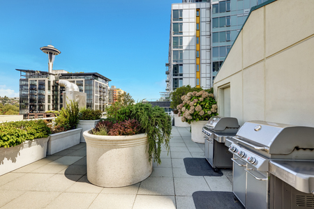 Apartment building roof top terrace exterior with barbecue area. Northwest, USA