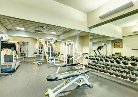 Interior of new modern gym with sport equipment. Northwest, USA Stock Photo