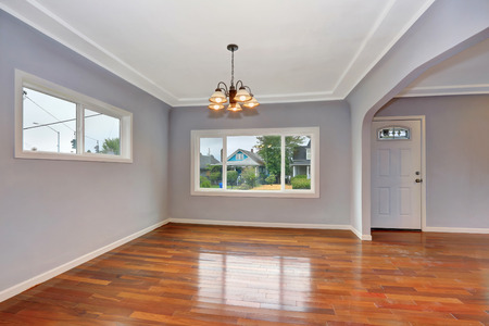 northwest: Empty Old house interior. Entryway with hardwood floor and lavender walls. Northwest, USA Stock Photo