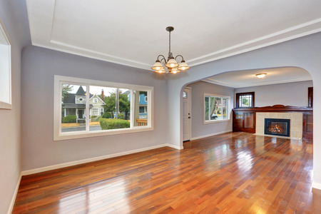 Empty Old house interior. Entryway with hardwood floor and lavender walls. Living room. Northwest, USA