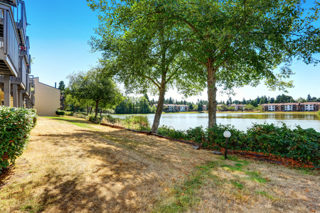 northwest: Condo apartment homes overlooking a small lake. Northwest, USA, Stock Photo