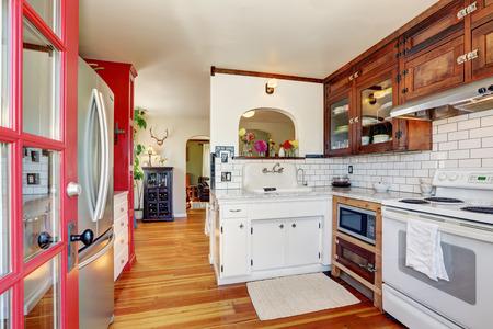 vintage kitchen: Vintage kitchen cabinets and white tile back splash trim. Kitchen interior. Northwest, USA