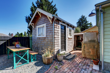 back yard: Small shed in the back yard of American rambler house. Northwest, USA
