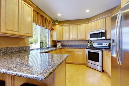 northwest: Light tones kitchen interior with modern steel appliances. Northwest, USA
